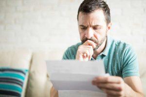 man looking at workers comp denial
