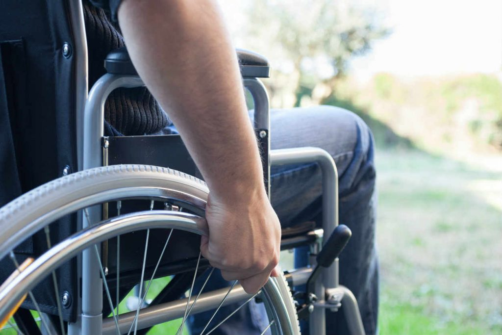 worker with spine injury in wheelchair