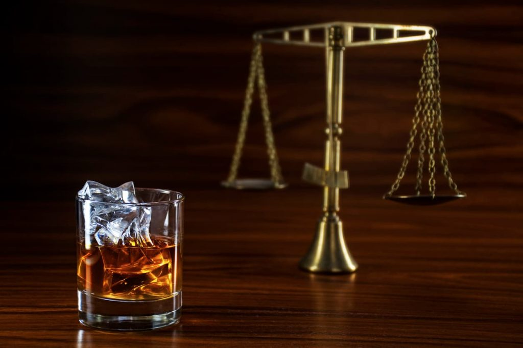 alcohol next to scales of justice