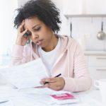 injured woman stressed over bills